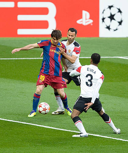 lionel-messi-of-fc-barcelona-with-ryan-giggs-and-patrice-evra-of-picture-id525919432