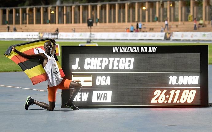 ugandan-athlete-joshua-cheptegei-waves-an-uganda-national-news-photo-1602107225