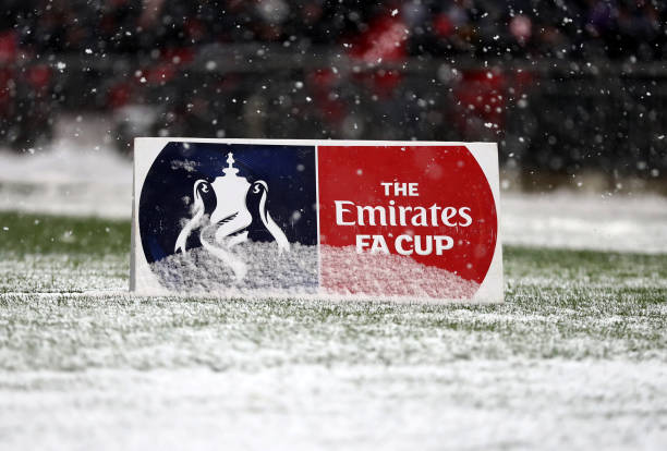 general-view-of-the-fa-cup-board-covered-in-snow-during-the-emirates-picture-id925591272