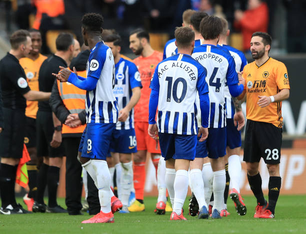 players-of-brighton-and-hove-albion-shake-hands-with-joao-moutinho-of-picture-id1210992209