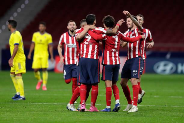 luis-suarez-of-atletico-de-madrid-celebrates-with-teammate-joao-felix-picture-id1284454610