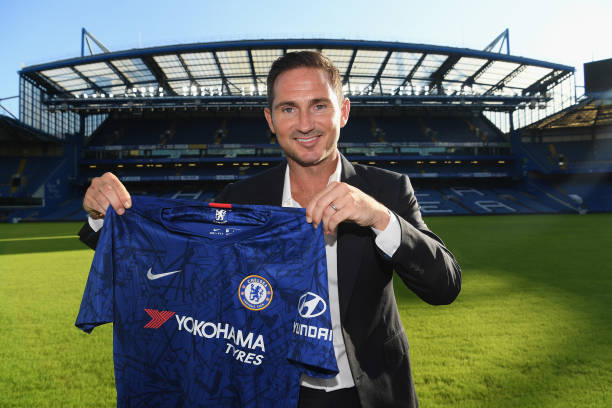 new-chelsea-manager-frank-lampard-holds-the-chelsea-shirt-as-he-is-picture-id1153597686